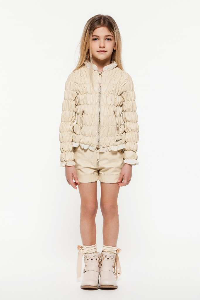 Magnolia white leatherette jackets with tulle inserts and matching shorts