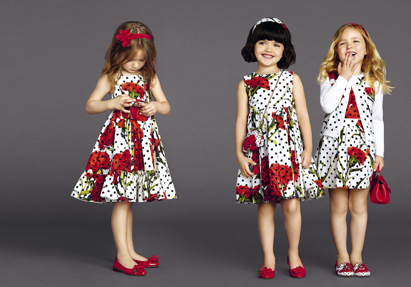 Dolce and Gabbana mini-me white dresses with black spots and red carnations