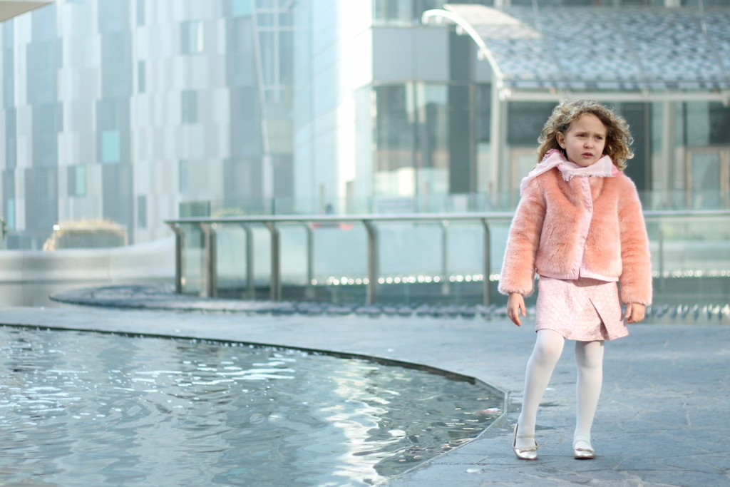 kenzo kids pink skirt and techno fur with Gucci sash