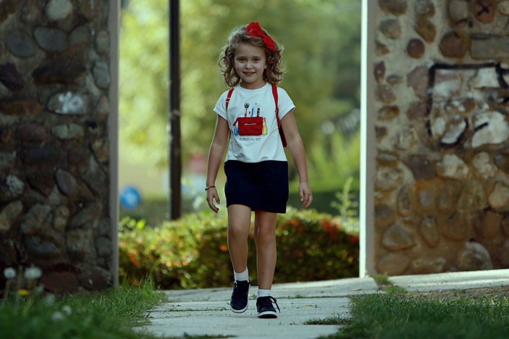 Monnalisa back to school 2015 dress with an appliquéd red make up bag