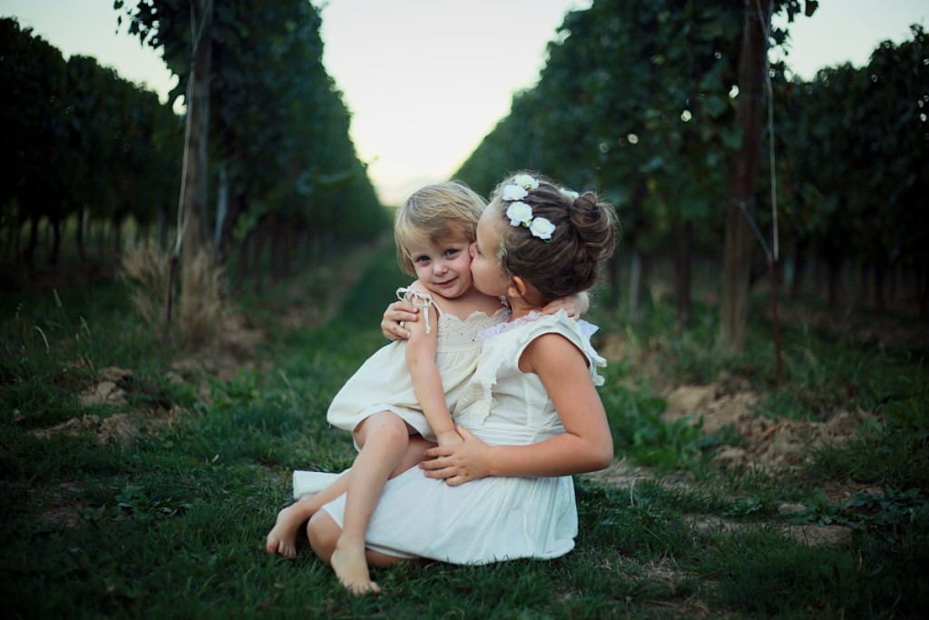Grape harvest 2015 Anna and Alice kissing in the vineyard
