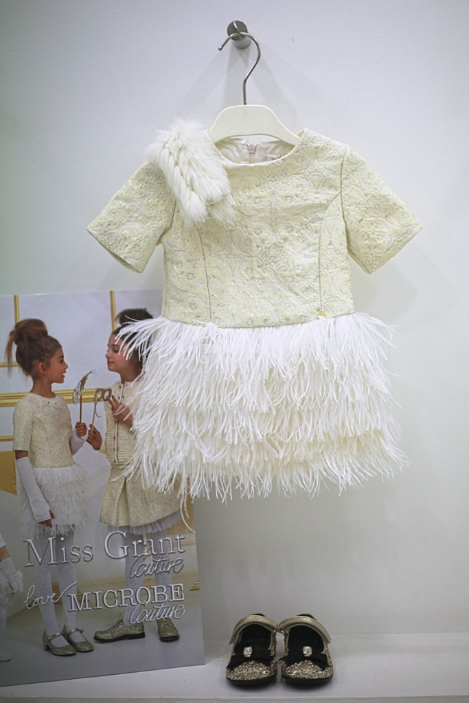 Miss grant winter 2015 ivory and gold dress with feather skirt