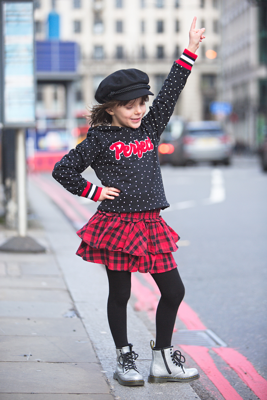 Vingino red and black plaid skirt combined with a black hoodie