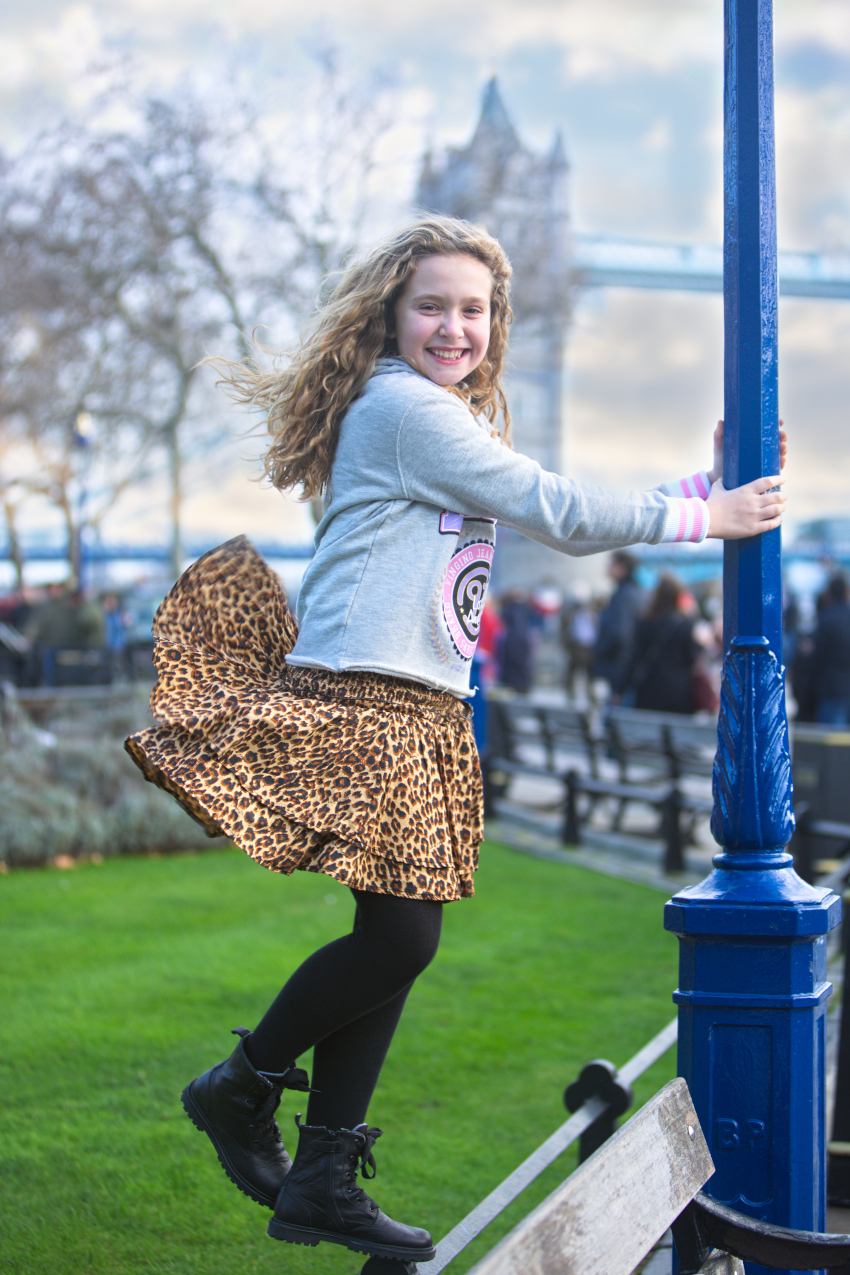 Anna wearing a leopard skirt from BYDANIE x VINGINO capsule collection matched with a grey hodie