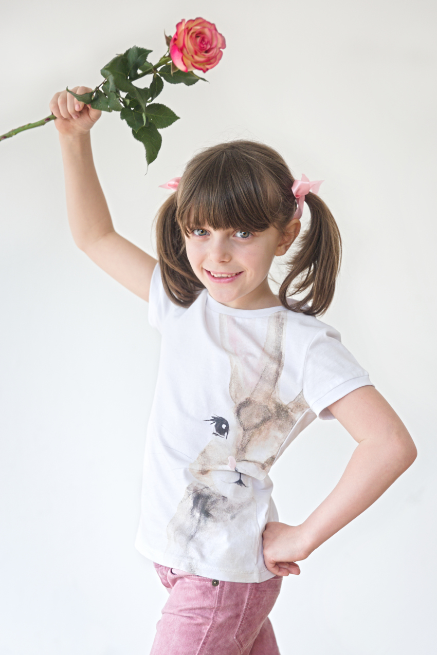Alice playing with a rose in ilgufo spring summer 2020