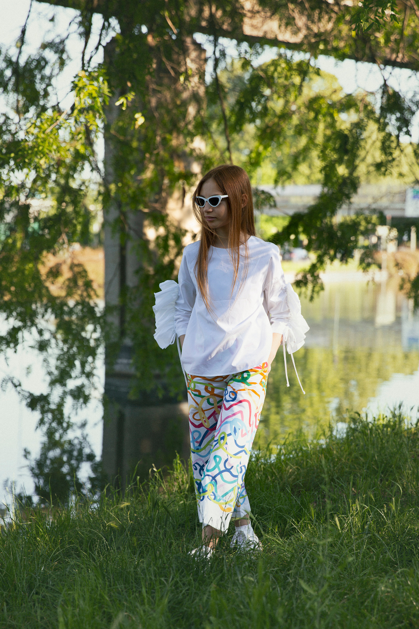 Emma in a white blouse and a pair of wide cropped trousers by Valmax SS20