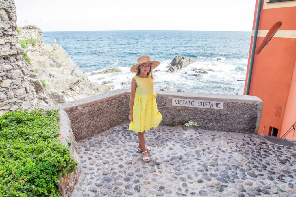Around Genoa Boccadasse in Magil yellow lace dress spring summer 2020
