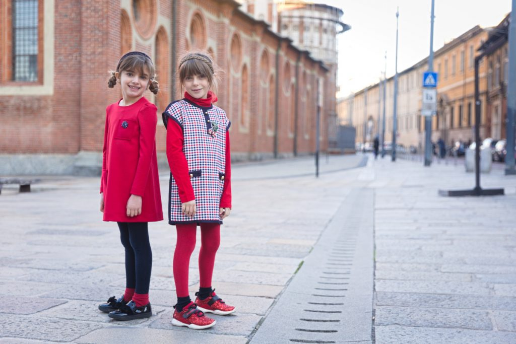 Giulia and Alice back to Milan and back to school with Mimisol red and blue!