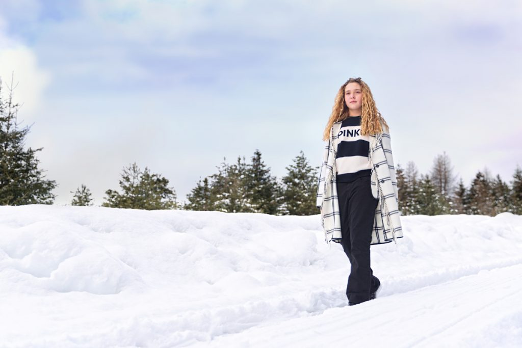 Back to the mountains in Pinko wearing a black and white outfit