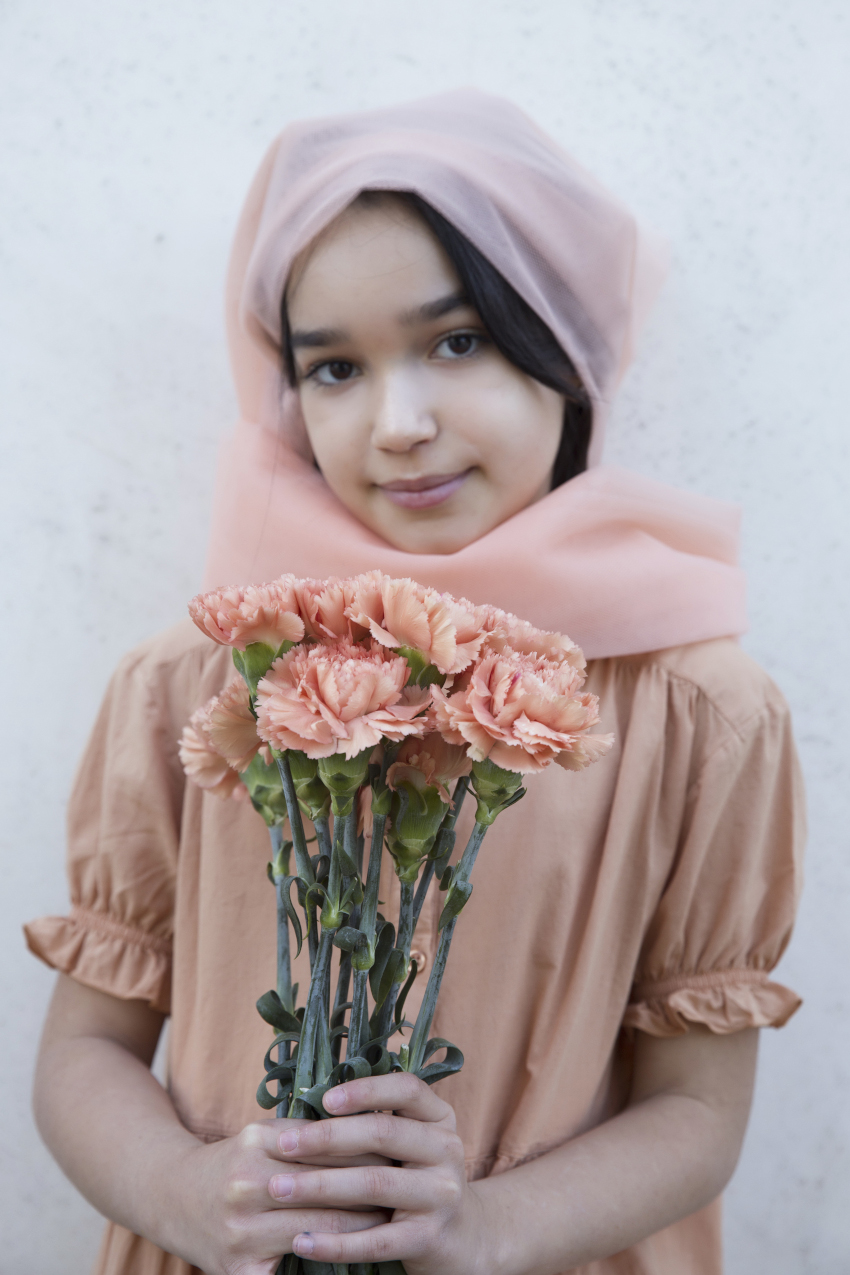 Blossoming Beauty Kids Fashion Editorial. Nicole is the peach carnation and wears a Repose AMS dress.