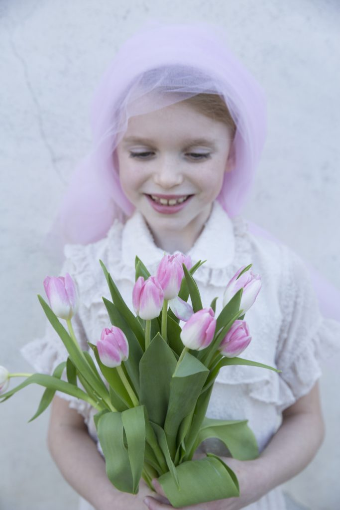 Micol is the pink tulip and wears a dress by Alitsa,