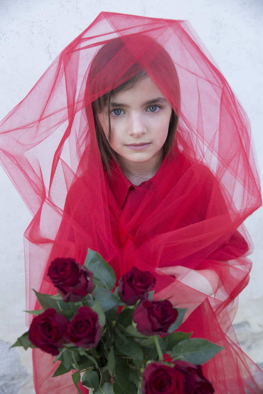 Blossoming Beauty Kids Fashion Editorial. Giulia is the red rose and wears a dress from Simonetta