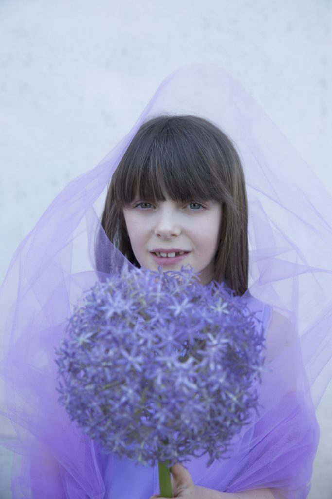 Alice is the lavender flower of ornamental garlic and wears an Elisabetta Franchi la mia bambina onesie.