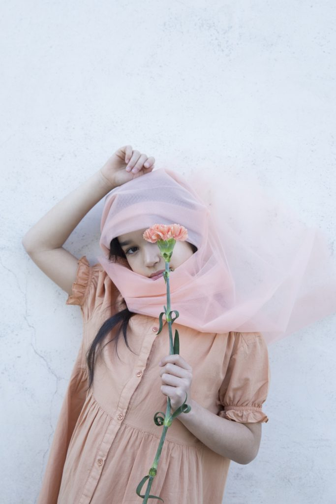 Blossoming Beauty Kids Fashion Editorial. Nicole is the peach carnation and wears a Repose AMS dress