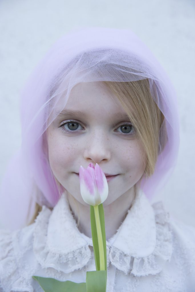 Micol is the pink tulip and wears a dress by Alitsa