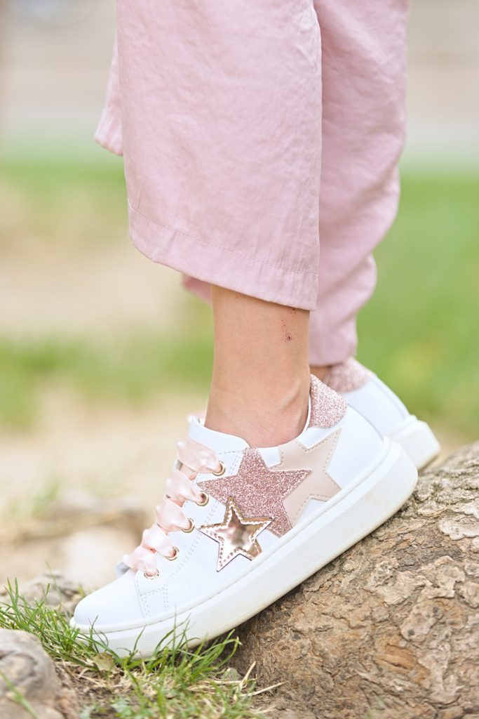 White leather sneakers by Morelli decorated with glittering pink and gold stars
