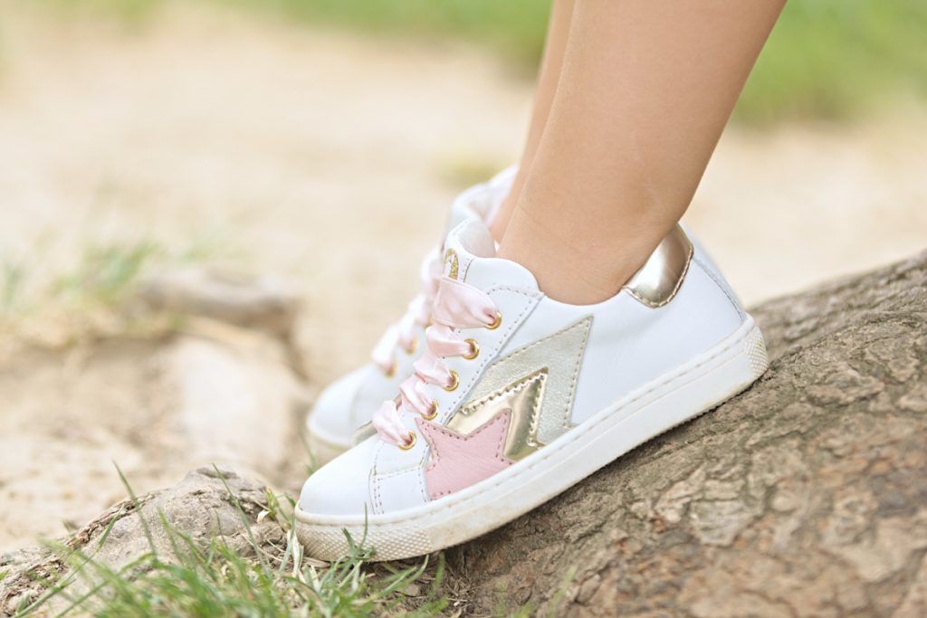 White leather sneakers by Walkey with pink and gold stars.
